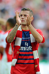 Arsenal's Jack Wilshere applauds the fans after winning the FA Community Shield - Photo mandatory by-line: Dougie Allward/JMP - Mobile: 07966 386802 10/08/2014 - SPORT - FOOTBALL - London - Wembley Stadium - Arsenal v Manchester City - FA Community Shield