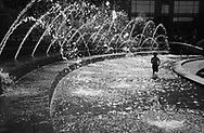 Refreshing fun in the Columbus Circle fountain.