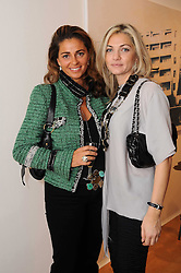 Left to right, JORIE GRASSIE and REEM DEBS at a pre lunch reception to celebrate the launch of the new Louisa Guinness gallery at Ben Brown Fine Art, Cork Street, London on 18th November 2009.