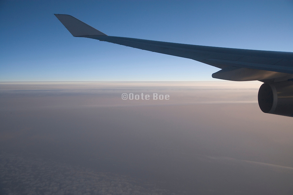 view of the soft light of the sky from an airplane window during flight