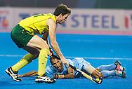 BHUBANESWAR (India) -  Hero Champions Trophy hockey men. Match for bronze. Australia vs India. Fergus Kavanagh of Australia with Sunil Sowmarpet of India.  Photo Koen Suyk