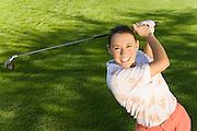 Golfer Swinging on Fairway