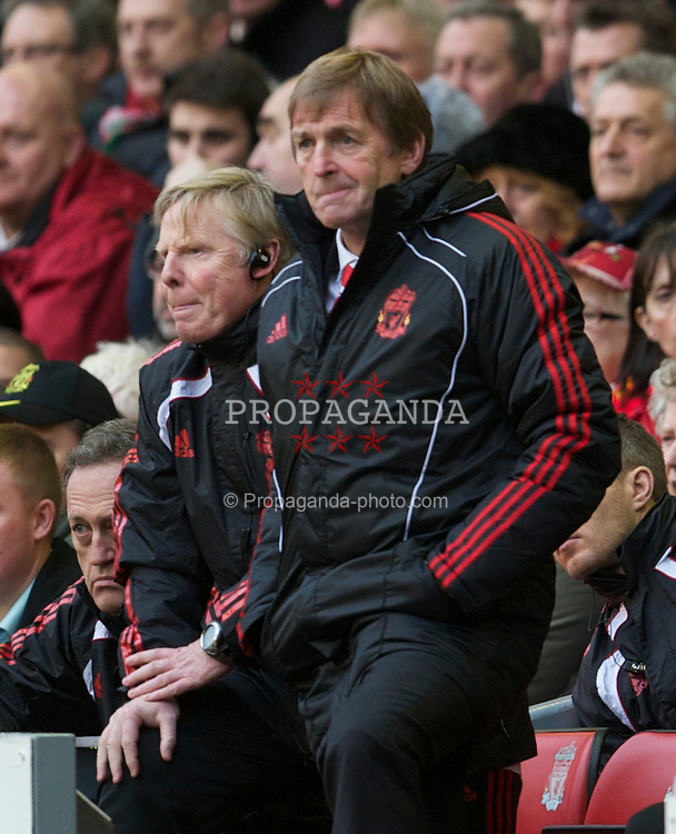 LIVERPOOL, ENGLAND - Sunday, January 16, 2011: Liverpool's manager Kenny Dalglish MBE and first team coach Sammy Lee during the Premiership match against Everton at Anfield. (Photo by: David Rawcliffe/Propaganda)