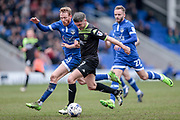 Ryan Lowe (Bury) under pressure from Paul Green (Oldham Athletic) during the EFL Sky Bet League 1 match between Oldham Athletic and Bury at Boundary Park, Oldham, England on 11 March 2017. Photo by Mark P Doherty.