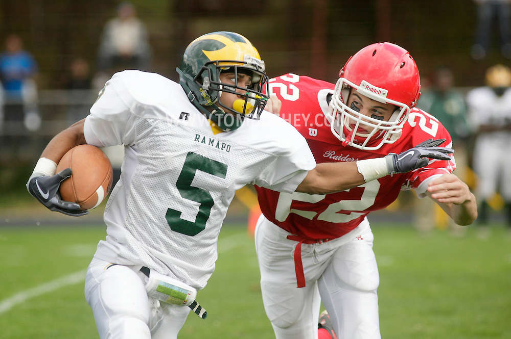 Thiells, New York - A Ramapo running back tries to elude a North Rockland defender during a high school football game on Sept. 26, 2009.