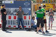 Berlin, Germany - 11.06.2016 <br /> <br /> Successful police operation against tricksters at Schlossbruecke in Berlin-Mitte. Police forces in in plain clothes arrest three thimblerigger.<br /> <br /> Erfolgreicher Polizeieinsatz gegen Trickbetrueger an der Schlossbruecke in Berlin-Mitte. Zivile Polizeikraefte verhaften drei H&uuml;tchenspieler.<br /> <br /> Photo: Bjoern Kietzmann