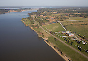 Aerial view of Jamestown Island on the James River at left and the Colonial Parkway at right. National historic park. Site of the first permanent English settlement in the new world