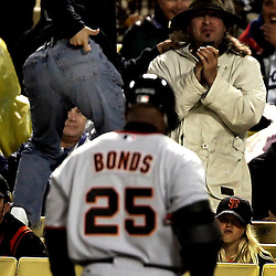 Giants Barry Bonds ,25, is taunted by a fan simulating a shot after flying out in the 2nd inning. Giants vs Dodgers at Dodger Stadium April 14. 2006.