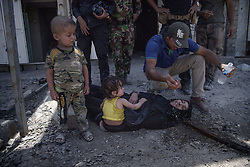 July 2, 2017 - Mosul, Syria - The final battle against the Isis in Mosul. Families flee through the alleys of old Mosul, Syria. A mother dies and her children refuse to abandon her. Finally the military took care of the children. (Credit Image: © Aftonbladet/IBL via ZUMA Wire)