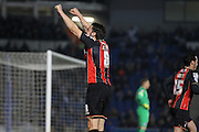 AFC Bournemouth midfielder Harry Arter celebrates AFC Bournemouth striker Yann Kermorgant during the Sky Bet Championship match between Brighton and Hove Albion and Bournemouth at the American Express Community Stadium, Brighton and Hove, England on 10 April 2015. Photo by Phil Duncan.