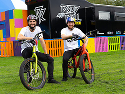 Edinburgh, Scotland, UK. 2 August 2019. Professional Trials riders Danny MacAskill and Duncan Shaw perform tricks on the Meadows. Danny MacAskill's Drop & Roll Live is a main highlight of this year's Underbelly Circus Hub programme. Pictured Duncan Shaw (L) and Danny MacAskill  Iain Masterton/Alamy Live News