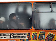 Nowosibirsk/Russische Foederation, RUS, 19.11.07: &Auml;ltere Frau schaut aus einem Stadtbus in der sibirischen Hauptstadt Nowosibirsk.<br /> <br />  Novosibirsk/Russian Federation, RUS, 19.11.07: Older woman is looking out of a city bus in the Sibirian capitol Novosibirsk.