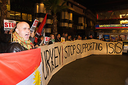 "London, October 25th 2014. Dozens of Britain's Kurdish community and their supporters demonstrated outside the exclusive Savoy as Turkey's ambassador welcomed guests to a ball. The Kurds accuse Turkey of helping Jihadists from ISIS in eradicating Kurds, who have held a long campaign for an autonomous Kurdish state. Pictured: Protesters demand that ""Turkey stops supporting ISIS"""
