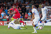 Charlie Taylor tackles Vadaine Oliver during the Friendly match between York City and Leeds United at Bootham Crescent, York, England on 15 July 2015. Photo by Simon Davies.
