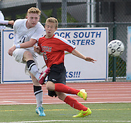 NEWTOWN, PA - SEPTEMBER 08: Council Rock's Dylan Schwartz (L) make a shot on goal as Hatboro Horsham's Matt Lenahan defends in the second half at Council Rock North high school September 8, 2014 in Newtown, Pennsylvania.  It was the first game since one of their teammates was killed in a car accident Labor Day weekend. (Photo by William Thomas Cain/Cain Images)