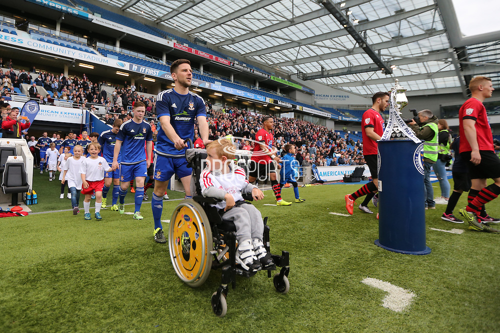 Players and mascots walk out before  the Sussex Senior Cup Final match between Eastbourne Borough and Worthing FC at the American Express Community Stadium, Brighton and Hove, England on 20 May 2016.