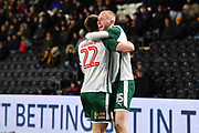 Barnsley FC midfielder Oliver McBurnie (15) celebrates scoring goal  with Barnsley FC midfielder Gary Gardner (22) to go 0-1 during the EFL Sky Bet Championship match between Hull City and Barnsley at the KCOM Stadium, Kingston upon Hull, England on 27 February 2018. Picture by Ian Lyall.