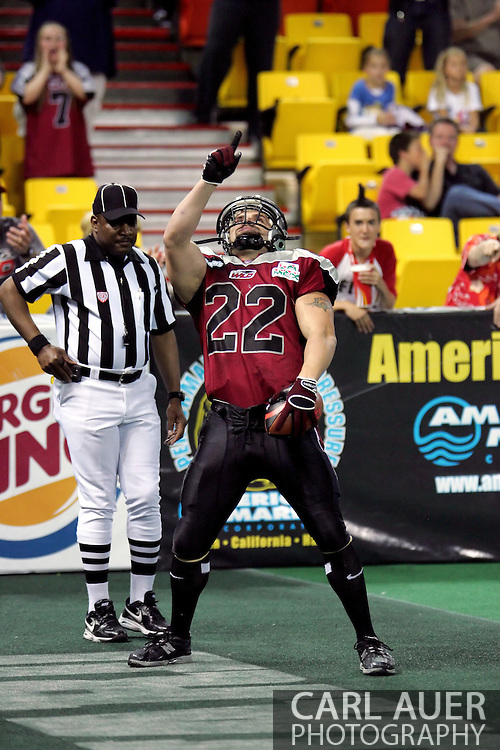 6-28-2007: Anchorage, AK - Dennis Short points to the sky after scoring a Wild touchdown, but it would not be enough for Alaska as the Alaska Wild drop another game 47 to 53 loss to the CenTex Barracudas at the Sullivan Arena...