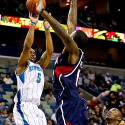 December 26, 2010; New Orleans, LA, USA; New Orleans Hornets guard Marcus Thornton (5) shoots over Atlanta Hawks center Josh Powell (12) during the first quarter at the New Orleans Arena.  Mandatory Credit: Derick E. Hingle