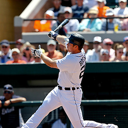 March 26, 2012; Lakeland, FL, USA; Detroit Tigers left fielder Brennan Boesch (26) hits a two run homerun during the bottom of the first inning of a spring training game against the Miami Marlins at Joker Marchant Stadium. Mandatory Credit: Derick E. Hingle-US PRESSWIRE