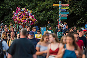 {Peopel cross the bridge into the Arena - The 2017 Latitude Festival, Henham Park. Suffolk 14 July 2017