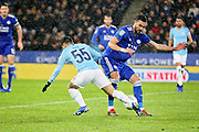 Leicester City midfielder Vicente Iborra (21) stops Manchester City's Brahim Diaz (55) during the quarter final of the EFL Cup match between Leicester City and Manchester City at the King Power Stadium, Leicester, England on 18 December 2018.