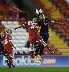 Bristol Academy Womens' Laura Del Rio Garcia and FC Barcelona's Laura Rafols jump for a high ball - Photo mandatory by-line: Paul Knight/JMP - Mobile: 07966 386802 - 13/11/2014 - SPORT - Football - Bristol - Ashton Gate Stadium - Bristol Academy v FC Barcelona - UEFA Women's Champions League
