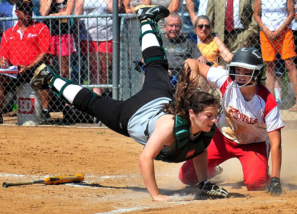Jen Ringsdorf slides in safetly under Holy Cross catcher Gabby Giordano.
