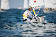 The Laser World Championships 2013 -  Standard. Mussanah Oman<br /> The final day of racing, Robert Scheidt (BRA) shown here in action and celebrating after winning the championships<br /> <br />  Oman.Credit: Lloyd Images.