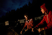 Blind Pilot vibes player Ian Krist, left, and drummer Ryan Dobrowski, right, enjoy a smoke behind the Peg House after the show and a long day riding on Highway 101 in Leggett, CA on September 18, 2008.