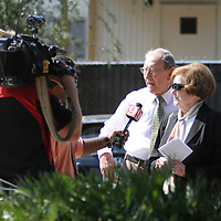 Local television stations interview voters as they turn out for an extended early voting session at the Winter Park Public Library in Winter Park, Florida on Sunday, November 4, 2012. A Florida judge granted extended early voting hours after two suspicious devices closed the Winter Park Library for several hours Saturday. (AP Photo/Alex Menendez)