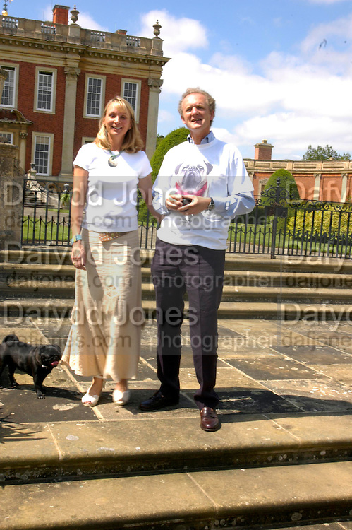 Mr. and Mrs. Alastair Macdonald-Buchanan with Coco. Pug Dog club Tea party held at Cottesbrook Hall.  ( home of  Mr. and Mrs. Alastair Macdonald-Buchanan ) 26 June 2005. . ONE TIME USE ONLY - DO NOT ARCHIVE  © Copyright Photograph by Dafydd Jones 66 Stockwell Park Rd. London SW9 0DA Tel 020 7733 0108 www.dafjones.com
