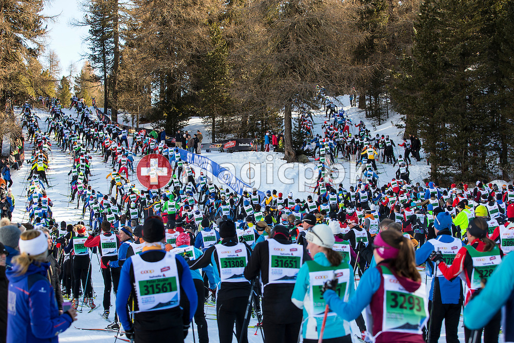 The pack passes by St. Moritz during the annual Engadine cross-country skiing marathon from Maloja to S-Chanf in south Eastern Switzerland, Sunday,  March 10, 2013. Around 12'500 sportsmen and -women participated in the event. (Photo by Patrick B. Kraemer / MAGICPBK)