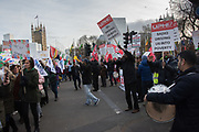 Minicab drivers protesing about the congestion charge cheer on a march to try to secure funding for maintained nursery schools.  outside Parliament, London. 11 March 2019