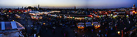Morocco, Marrakesh. Jamaa el Fna is a square and market place in Marrakesh's medina quarter (old city). Panorama of the square after dark.