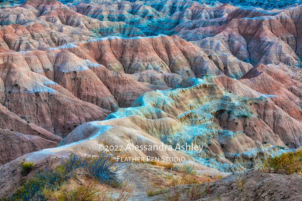 Wide-angle view of sand formations in blue-tinted light at Badlands National Park, South Dakota, USA.