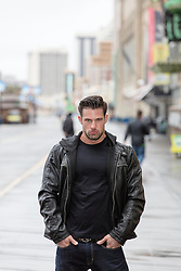 rugged handsome man in black tee shirt and leather jacket in Atlantic City, NJ