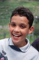 Portrait of young boy laughing,