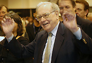 5/1/04 Omaha, Neb. Warren Buffett signals to crowd that follows him around at the  Berkshire Hathaway shareholders meeting at Qwest Center Omaha Saturday morning.  (Photo by chris machian)