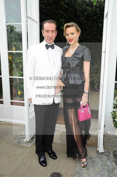 ROBERT HANSON and his wife MARSHA MARKOVA at the Raisa Gorbachev Foundation Party held at Stud House, Hampton Court Palace on 5th June 2010.  The night is in aid of the Raisa Gorbachev Foundation, an international fund fighting child cancer.