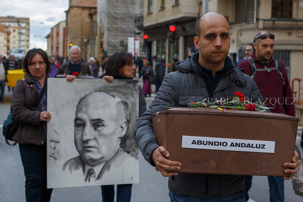 14/04/2018. Great grandson (R) carry a coffin containing the remains of victim of Spain Civil War Abundio Andaluz as his granddaughters Maria Luisa (L) and Ana Maria (C) carry a portrait depicting him along the streets in center of Soria during a homage to hand the remains to their families on April 14, 2018 in Soria, Spain. La Asociacion Soriana Recuerdo y Dignidad (ASRD) 'The Soria Association for Memory and Dignity' celebrated a tribute to hand over the remains of civil war victims to their families. The Society of Sciences of ARANZADI helped with the research, exhumation and identification of the bodies, after villagers passed the information about the mass grave, 81 years after the assassination took place, to the ASRD. Seven people were assassinated around August 25, 1936 by Falangists, as part of General Francisco Franco armed forces, and buried in the 'Fosa de los Maestros' (Teachers Mass Grave) near Cobertelada, Soria, after being taken from prison of Almazan during the Spanish Civil War. Five of them were teachers in the region, and also friends of Spanish writer Antonio Machado. The other two still remain unidentified. Another body was assassinated by Falangists accompanied by a priest in 1936, and was exhumed on 23 September of 2017 near Calata&ntilde;azor, Soria. It belonged to Abundio Andaluz, a politician, lawyer and musician in Soria.<br /> Spain's Civil War took the lives of thousands of people on both sides, and civilians. But Franco continued his executions after the war has finished. Teachers, as part of the education sector, were often a target of Franco's forces. Spanish governments has never done anything to help the victims of the Civil War and Franco's dictatorship while there are still thousands of people missing in mass graves around the country. (&copy; Pablo Blazquez)