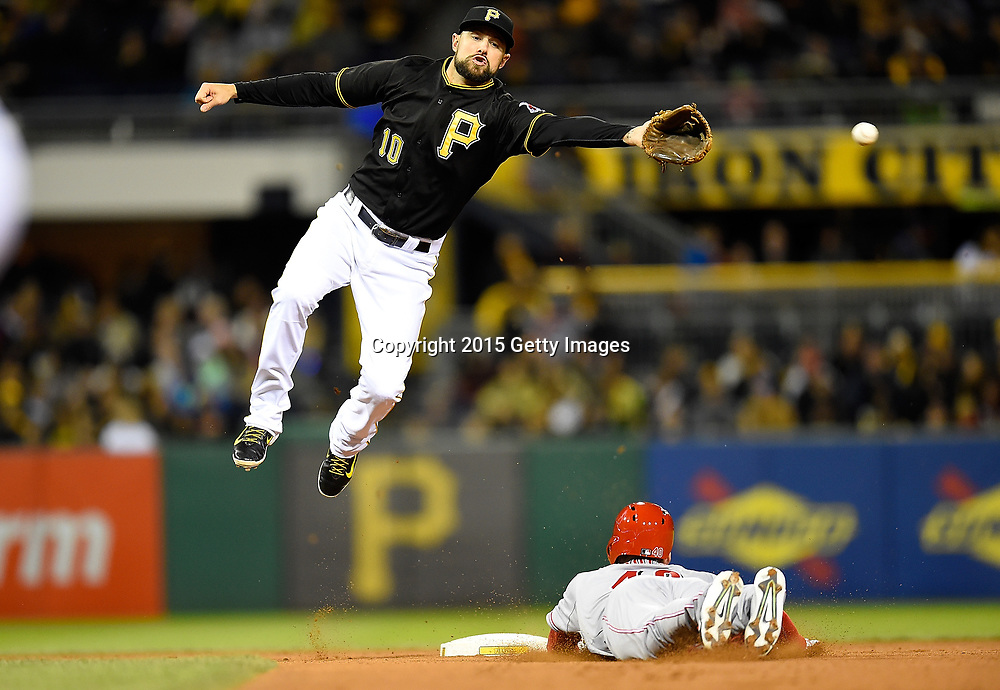 PITTSBURGH, PA - OCTOBER 2:  Tyler Holt #40 of the Cincinnati Reds safely steals second base in front of Jordy Mercer #10 of the Pittsburgh Pirates during the fourth inning on October 2, 2015 at PNC Park in Pittsburgh, Pennsylvania.  (Photo by Joe Sargent/Getty Images) *** Local Caption ***