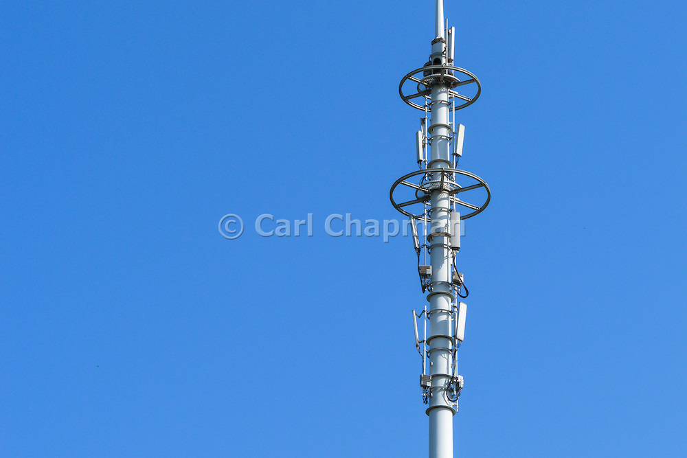 Stacked GSM and CDMA cellsite base station antenna array for the cellular telephone system on a pole tower - Nanjing, China
