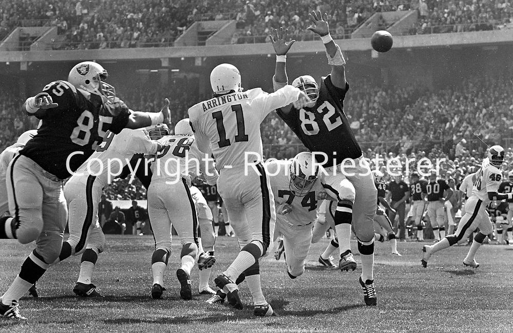 Raiders Carleton Oats and Horace Jones put the rush on Phadelphia Eagles QB Rick Arrington. (1971 photo/Ron Riesterer)