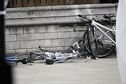 © Licensed to London News Pictures. 14/08/2018. London, UK. Damaged bicycles lie on the pavement outside Parliament after a car crashed into security barriers outside Parliament. A man had been arrested. A number of people are injured. Photo credit: Peter Macdiarmid/LNP