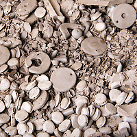 Africa, Kenya, Nairobi. Unpainted clay beads discarded and rejected at the Kazuri bead making factory in Karen district of Nairobi.