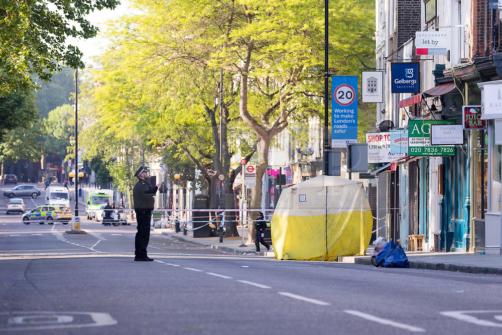 © Licensed to London News Pictures. 22/05/2018. London, UK. Police forensic tent in Upper Street, Islington this morning. Police were called at approximately 18:30hrs on Monday, 21 May to reports of a man suffering stab injuries after being attacked in Upper Street.<br /> Officers and London Ambulance Service attended. The man was pronounced dead at the scene. Photo credit: Vickie Flores/LNP