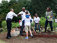 "President Barack Obama gives Olanzo Mourning an ""arm bump"" as he  joins  First Lady Michelle Obama as the first lady dedicates White House Kitchen Garden and Highlights Impact of Let's Move! on Healthy Living.Photo by  Dennis Brack"