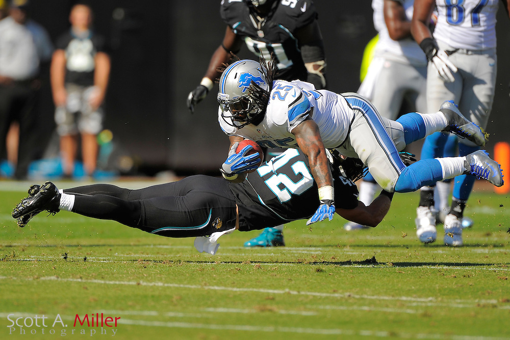 Detroit Lions running back Mikel Leshoure (25) is tackled by Jacksonville Jaguars free safety Chris Prosinski (42) during his team's 31-14 win at EverBank Field on November 4, 2012 in Jacksonville, Florida. ..©2012 Scott A. Miller..