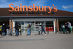 © Licensed to London News Pictures. 22/03/2020. London, UK. Shoppers queue at a Sainsbury's in Harringay, north London before the store opens, as the spread of the Coronavirus continues in the capital. Photo credit: Dinendra Haria/LNP